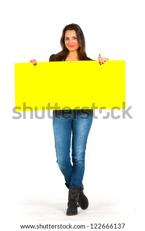 Beautiful woman holding a yellow, blank paper - stock photo