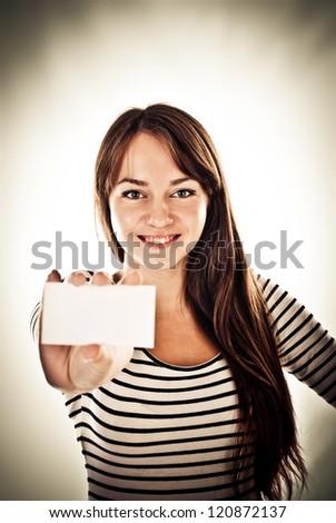 beautiful woman holding empty card - stock photo