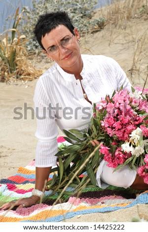 beautiful woman holding flowers - stock photo
