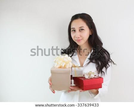 Beautiful woman holding gift box - stock photo