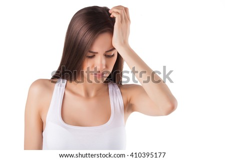 beautiful woman holding her head with her hands. headache. migraine. - stock photo