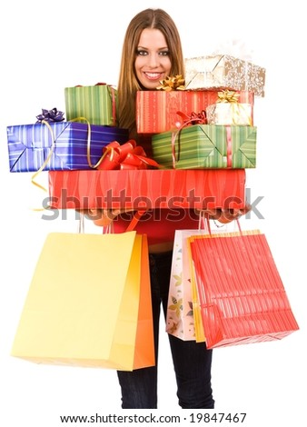 Beautiful woman holding many gift boxes and bags. - stock photo