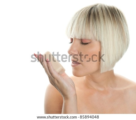 beautiful woman holding organic soap - stock photo