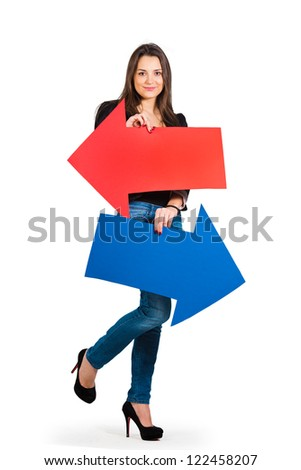 Beautiful woman holding red and blue arrow, left and right - stock photo