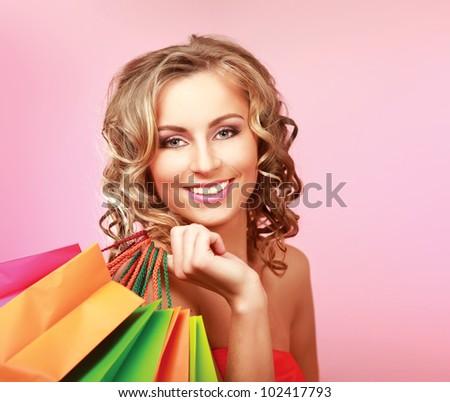 Beautiful  woman holding shopping bags - stock photo