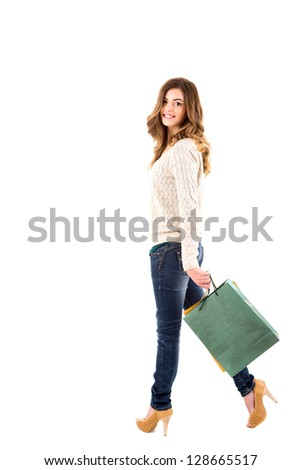 Beautiful woman holding shopping bags over white background - stock photo