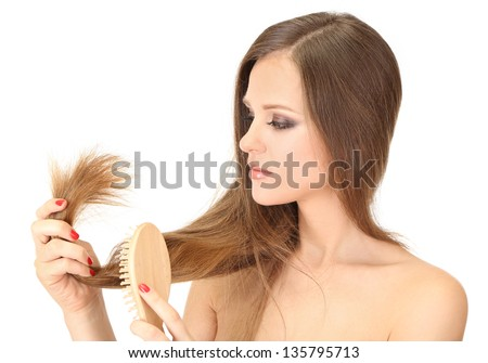 Beautiful woman holding split ends of her long hair, isolated on white - stock photo