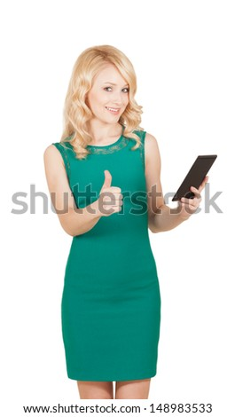 Beautiful woman holding tablet giving thumbs up over white - stock photo