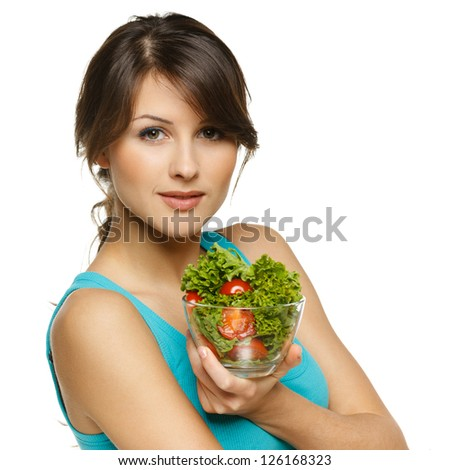 Beautiful woman holding transparent bowl with healthy salad meal, over white - stock photo