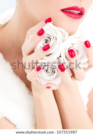 Beautiful woman holding tree roses. - stock photo