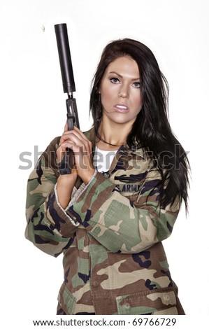 Beautiful woman holding weapon - stock photo