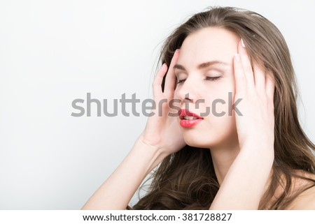 Beautiful woman holds a head, suffering from a headache. migraine - stock photo