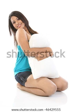 Beautiful woman hugging the soft pillow - stock photo