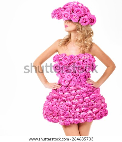 Beautiful woman in a dress and hat of flowers. Pink roses. - stock photo