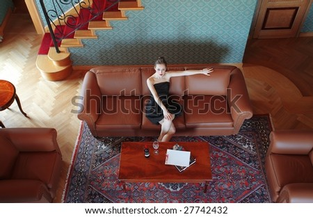 Beautiful woman in a luxury living room - stock photo