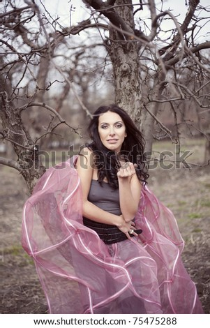 beautiful woman in a pink skirt fashion in the fairy forest - stock photo
