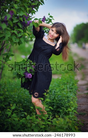 beautiful woman in a spring park. - stock photo