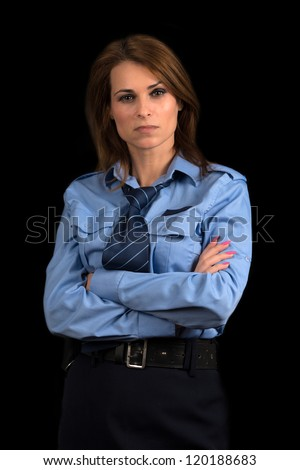 Beautiful woman in a uniform of police officer on a black  background - stock photo
