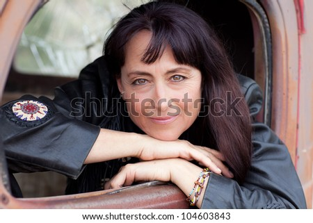 Beautiful Woman in a Vintage truck smiling confidently - stock photo