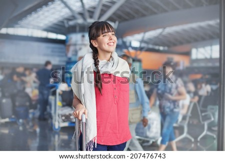 Beautiful woman in airport - stock photo