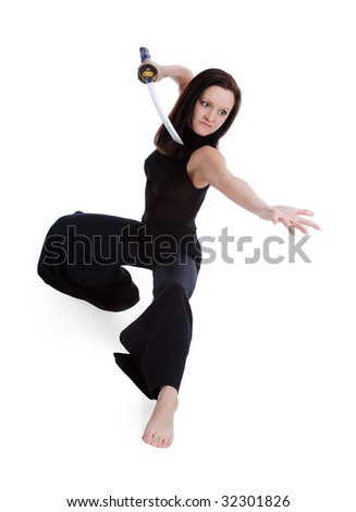 Beautiful woman in an aggressive posture with a sword on a white background - stock photo