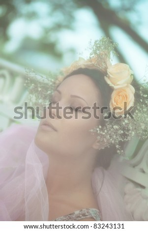 Beautiful woman in an outdoor setting - stock photo