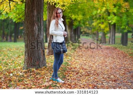 Beautiful woman in autumn park - stock photo