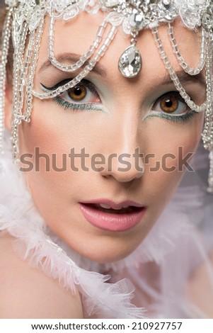 Beautiful woman in beaded headpiece - stock photo
