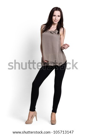 Beautiful woman in beige blouse with emotions - stock photo