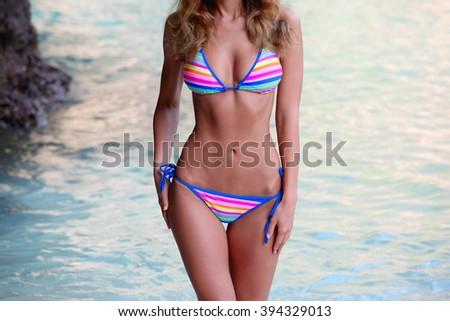 Beautiful woman in bikini standing in water at Maya bay, Thailand - stock photo