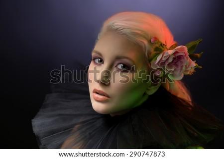 Beautiful woman in black collar - stock photo