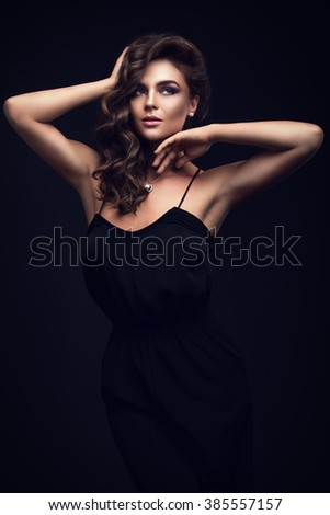 Beautiful woman in black dress - stock photo