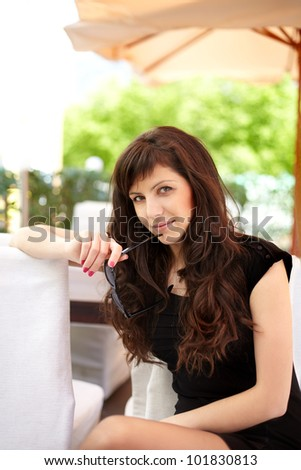 Beautiful woman in cafe. With sun glasses. - stock photo