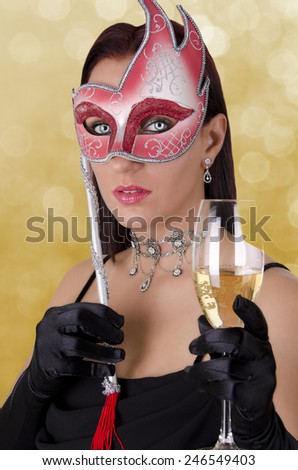 Beautiful woman in carnival mask - stock photo