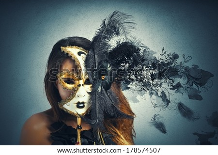 Beautiful woman in carnival mask with motion effect - stock photo