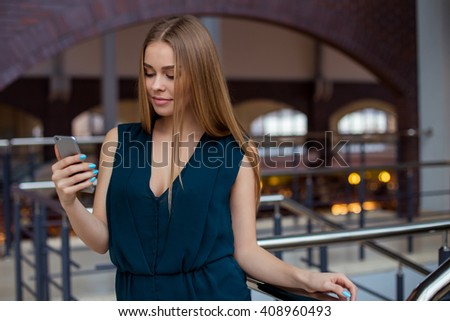 Beautiful woman in casual clothes is making a selfie using a smart phone - stock photo
