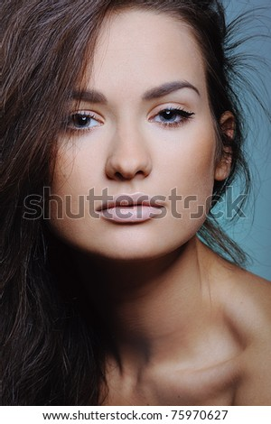 beautiful woman in color paint behind the painted glass - stock photo