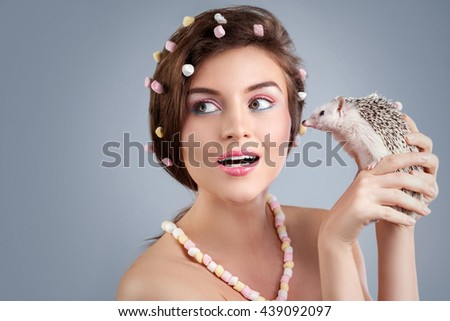 Beautiful woman in creative image with marshmallow with hedgehog  - stock photo