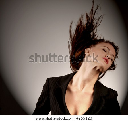 Beautiful woman in Ecstasy dancing on multi background - stock photo