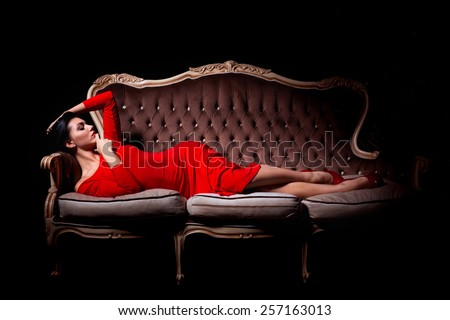 Beautiful woman in elegant dress in luxury interior - stock photo