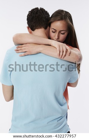 Beautiful woman in embrace, white background - stock photo