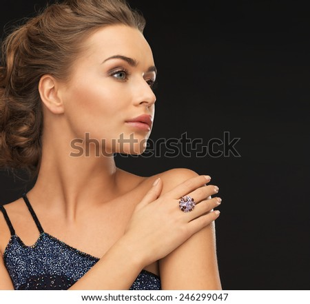 beautiful woman in evening dress with cocktail ring - stock photo