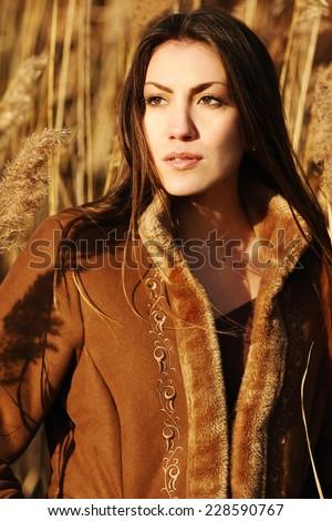 Beautiful woman in field  - stock photo