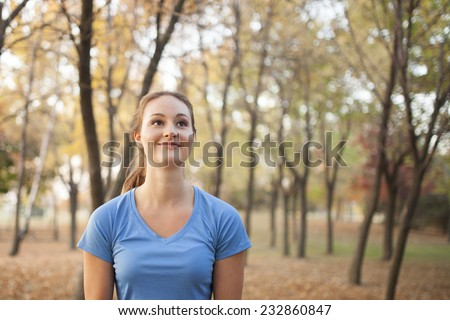 Beautiful woman in forest hold leaves during autumn - stock photo
