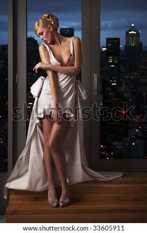 beautiful woman in front of night city - stock photo