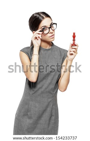 Beautiful woman in glasses holding chess figure, king, isolated - stock photo