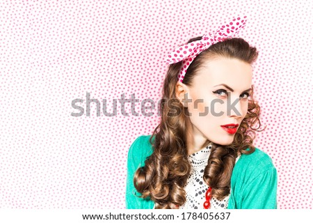 Beautiful woman in green excited looking to the side on bright background - stock photo