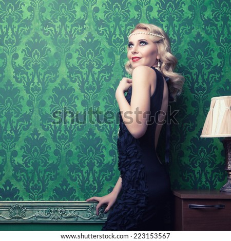 Beautiful woman in green vintage interior toned image. Professional make up. Studio lighting - stock photo