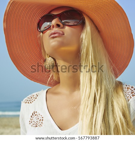 beautiful woman in hat on the beach.summer girl in sunglasses - stock photo