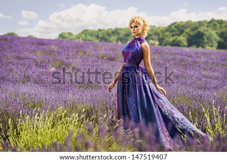 Beautiful woman in lavender fields, fashion theme - stock photo